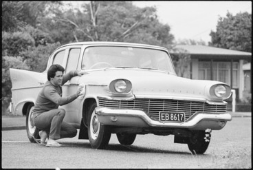 Image: Tony Edwards polishing his 1958 Studebaker Champion car, Lower Hutt - Photograph taken by Phil Reid