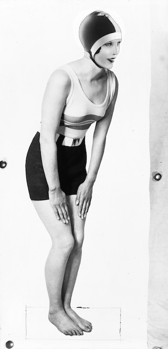 Image: Young woman modelling bathing suit and cap