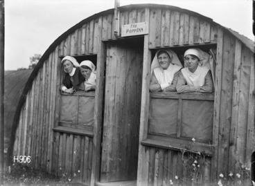 Image: Four nursing sisters look out of the windows of the New Zealand Stationary Hospital, Wisques, France