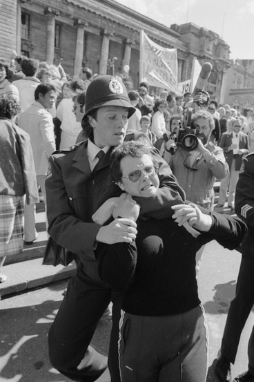 Image: Woman being restrained by a policewoman during demonstration against presentation of a petition opposing the Homosexual Law Reform Bill - Photograph taken by Phil Reid