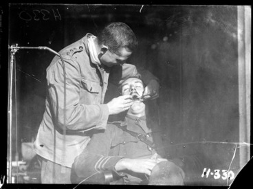 Image: A New Zealand Dental Corps dentist carrying out an inspection during World War I