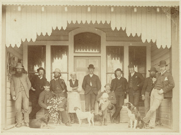 Image: Group of men and dogs on a veranda