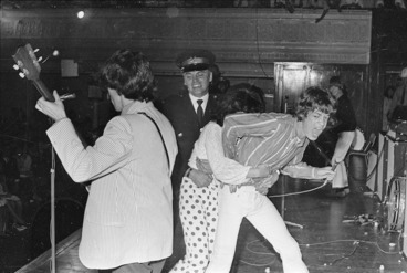 Image: Security guard restraining fan during Rolling Stones concert, Wellington Town Hall