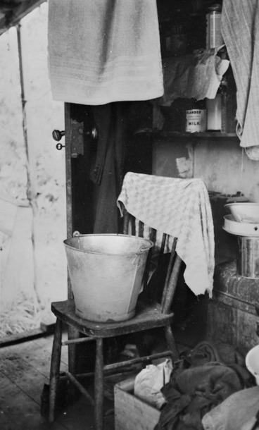 Image: Interior of Frank Sargeson's bach at Esmonde Road, Takapuna, Auckland; includes a bucket and towels