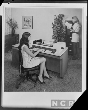 Image: Woman working with computers in office