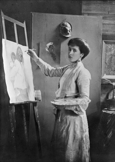 Image: Portrait of Frances Mary Hodgkins painting at an easel in her studio in Bowen Street