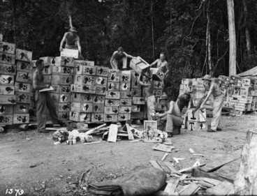 Image: New Zealand soldiers opening boxes of supplies