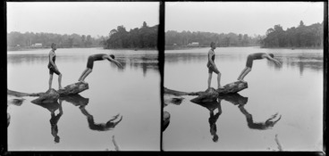 Image: Two young men wearing bathing costumes, diving from a log in the Owaka River, Catlins District, Otago Region