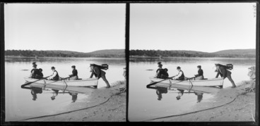 Image: Man, launching a boat, rowed by a man and woman with a woman and child in the rear, Catlins, Otago