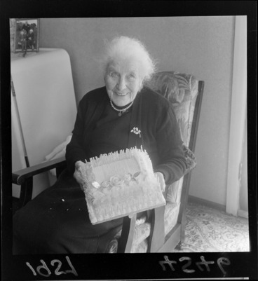 Image: Mrs Dumbleton holding a birthday cake