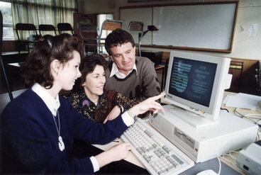 Image: Upper Hutt College; Jennifer Risdon demonstrates computer to founding students Heather Marryatt, David Head.