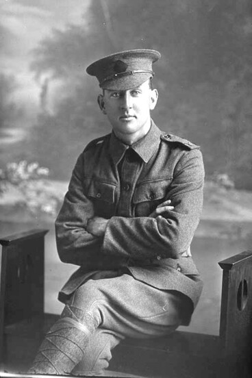 Image: Full portrait of Rifleman Claude Roy Ayling seated. Reg No. 23/59, of the New Zealand Rifle Brigade.