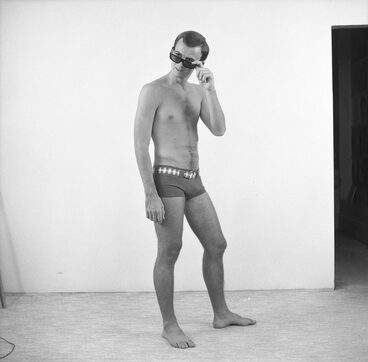 Image: Portrait of Hugh Porter in swimming togs and sunglasses