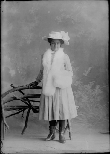 Image: Full length portrait of Princess Tabou, standing beside a....