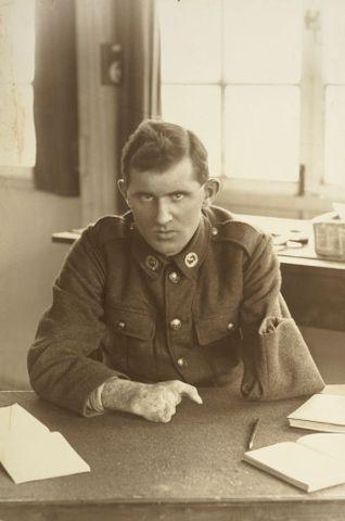 Image: WWI soldier Allan McMillan sitting at a desk at Oatlands Park, Surrey, England