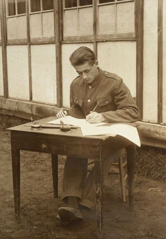 Image: Unidentified WWI soldier with a prosthetic right hand learning to write with his left hand at Oatlands Park, Surrey, England