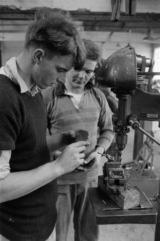 Image: (Men inside workshop)