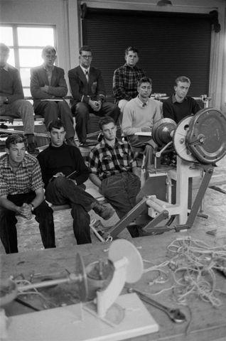 Image: Group of men inside workshop