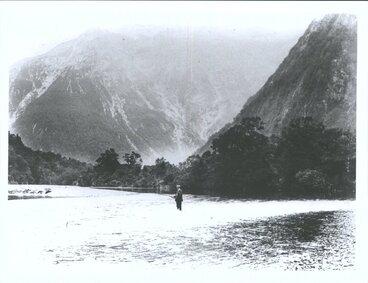Image: Unidentified man fishing in the Waiau River