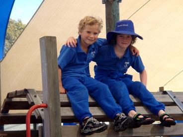 Image: Best buddie in the playground at Freeville School