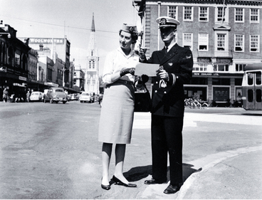 Image: Male and female cabin crew of TEAL standing at the corner of Colombo and Armagh Streets