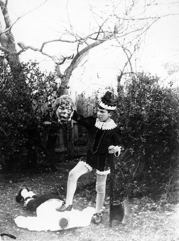 Image: Theatrical scene of a boy having executed a fairy tale monster : photograph