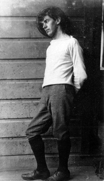 Image: A man leaning against a wall