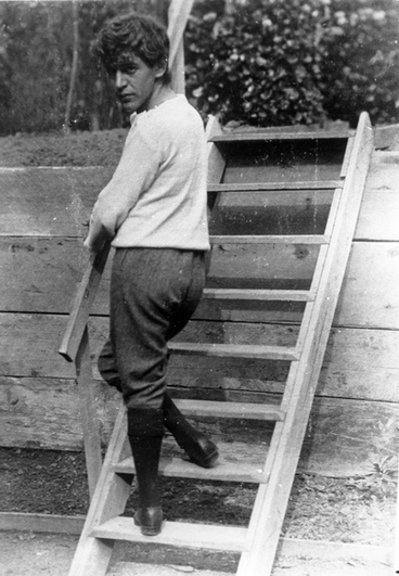 Image: A theatrical scene of a man walking up a set of stairs