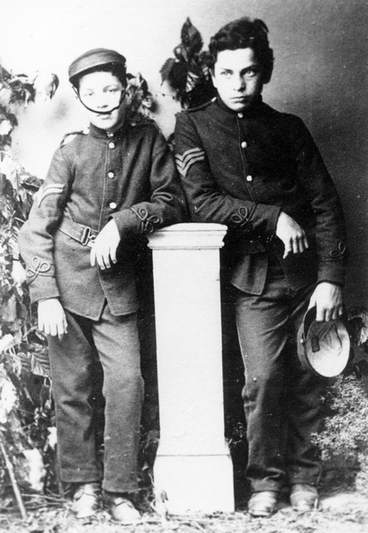 Image: Two boys dressed in military costume