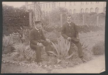 Image: [Two guards sitting on tree stumps smoking, Avondale Lunatic Asylum]