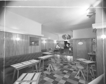 Image: [Restaurant interior with pianist]