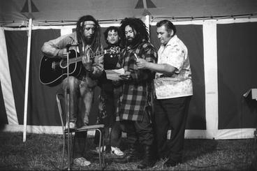 Image: Four performers with guitar, Parihaka Concert
