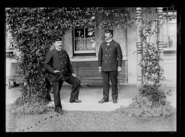 Image: [Portrait of two male attendants on the veranda of the  Avondale Lunatic Asylum]