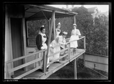 Image: [Portrait of four unidentified nurses]