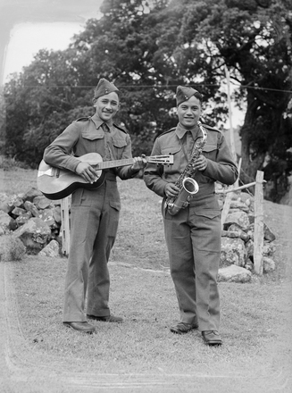 Image: [Portrait of two military servicemen with guitar and saxophone]