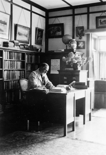 Image: Algernon Charles Gifford sitting in his library at home, Chatsworth Road, Silverstream