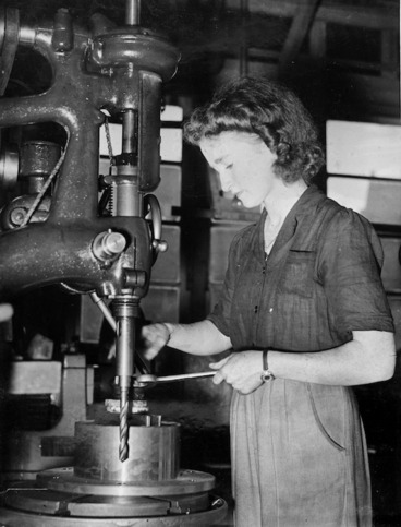 Image: Woman working a drill press