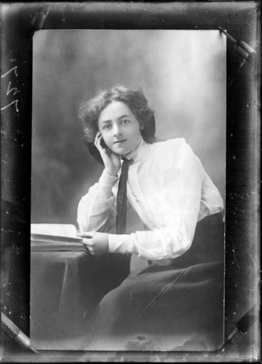 Image: Studio portrait of an unidentified girl, seated, with a book, probably Christchurch district