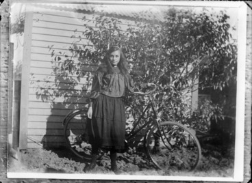 Image: Unidentified girl with bicycle outside a house, probably Christchurch district