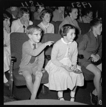 Image: Children and parents, watching the pantomime, Wellington