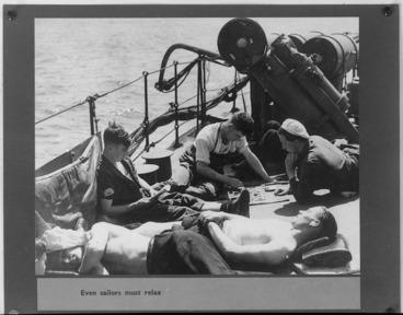 Image: Royal Navy sailors at leisure on deck during World War II