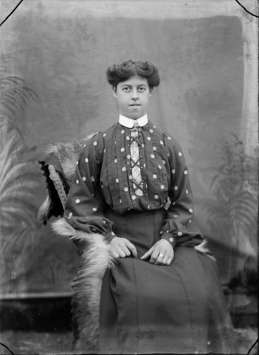 Image: Studio portrait of unidentified woman, wearing a polka dot blouse and tie, probably Christchurch district