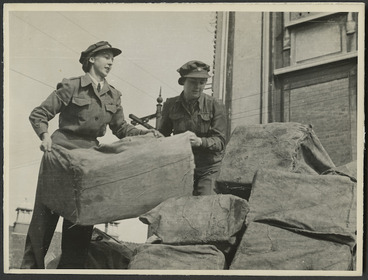 Image: Women from the Post and Telegraph Department lifting mail bags - Photograph taken by Government Film Studios