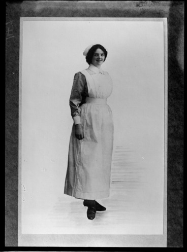 Image: Full length portrait of an unidentified woman, in a nurse's uniform, probably Christchurch district