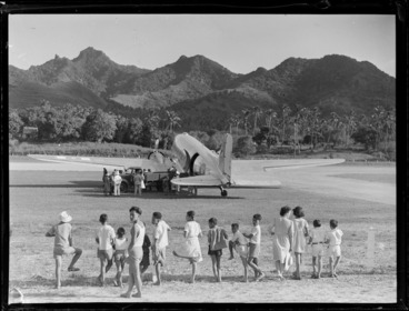 Image: C47 aircraft at Rarotonga airfield, Cook Islands, includes local island children in the foreground