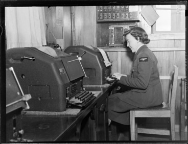 Image: View of unidentified WAAF using a teleprinter, Meteorological Section, Mechanics Bay, Auckland City