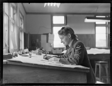 Image: View of an unidentified Meteorological Section WAAF (Women's Auxiliary Air Force) at work at her drawing board, Mechanics Bay, Auckland City