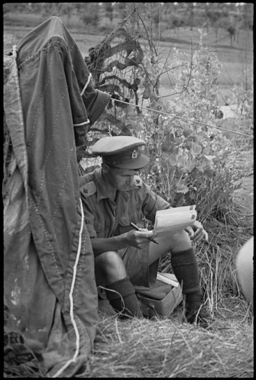 Image: Lieutenant A R Martin censoring mail outside his bivy near Sora, Italy, World War II - Photograph taken by George Kaye