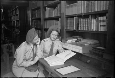 Image: Off duty Tuis examining mementos of John Keats in Rome, Italy, World War II - Photograph taken by George Kaye