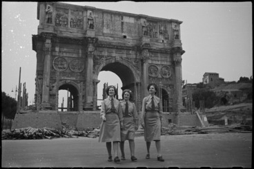 Image: Tuis standing in front of the Arch of Constantine in Rome, Italy, World War II - Photograph taken by George Kaye